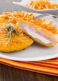 Chicken cordon bleu with grated carrots. Closeup of chicken cordon bleu with grated carrots Stock Photography