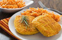 Chicken cordon bleu with grated carrots. Royalty Free Stock Photography