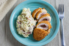 Chicken Cordon Bleu. On a plate with rustic mashed potatoes Stock Images