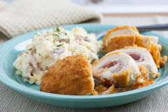 Chicken Cordon Bleu. On a plate with rustic mashed potatoes Royalty Free Stock Photos