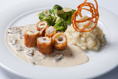 Chicken Cordon bleu on a plate with rustic mashed potatoes. Stock Images