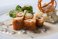 Chicken Cordon bleu on a plate with rustic mashed potatoes. Royalty Free Stock Image