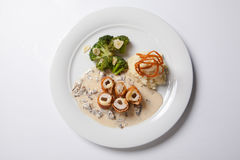 Chicken Cordon bleu on a plate with rustic mashed potatoes. Stock Photography