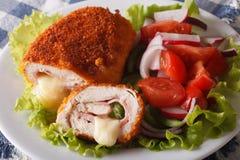 Chicken cordon bleu and vegetable salad closeup. horizontal Royalty Free Stock Photos