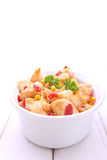 Chicken with corn and bell pepper in a dish Stock Image