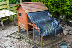 Chicken coup with concrete base and improvised waterproof cover. Used for free range chickens kept in a garden in Northern Ireland.m Royalty Free Stock Photo