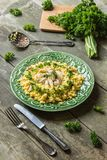 Chicken couscous. Decorated with fresh parsley on a wooden table board royalty free stock image