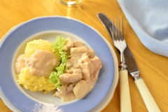 Chicken in a cream sauce with polenta Stock Image