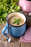 Chicken cream soup with cheese in mug. Stock Image