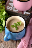 Chicken cream soup with cheese in mug. Royalty Free Stock Photography