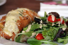 Chicken Croissant and a side of salad. Chicken Croissant with cheese and a side of salad Royalty Free Stock Images