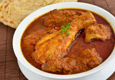 Chicken Curry. Indian Dish of Chicken curry with Parotha royalty free stock image