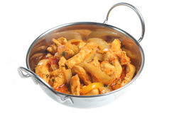 Chicken Curry. Indian chilli chicken curry in serving dish Royalty Free Stock Photos