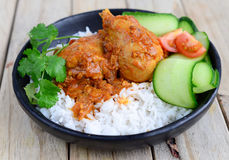 Chicken Curry with basmati rice. Indian Dish of Chicken Curry with salad and basmati rice Royalty Free Stock Photo
