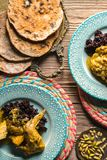 Chicken curry with black rice, serving close-up. Indian food Stock Images