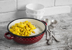 Chicken curry with chickpeas and rice in a vintage enamel bowl Stock Photo
