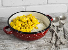 Chicken curry with chickpeas and rice in a vintage enamel bowl royalty free stock photos