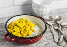 Chicken curry with chickpeas and rice in a vintage enamel bowl Royalty Free Stock Image
