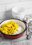 Chicken curry with chickpeas and rice in a vintage enamel bowl Stock Photos