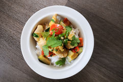 Chicken curry. Chicken curry-coconut milk, chicken meat, sesame oil, pepper, fresh coriander, red bell pepper, red curry paste, zucchini, spring onion stalks royalty free stock photo