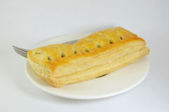Chicken curry filled pie and fork on dish Royalty Free Stock Image