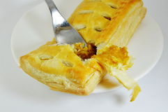 Chicken curry filled pie and fork on dish Royalty Free Stock Photos