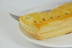 Chicken curry filled pie and fork on dish Stock Photo