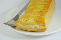 Chicken curry filled pie and fork on dish Royalty Free Stock Images