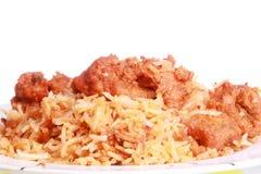 Chicken curry over chicken biryani Royalty Free Stock Photography
