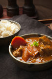 Chicken curry and rice. Spicy indian chicken curry and rice on a table Royalty Free Stock Photo