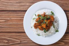 Chicken curry with rice and cilantro on a plate top view Stock Photos