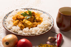Chicken curry with rice and ingredients on the white board. Stock Image