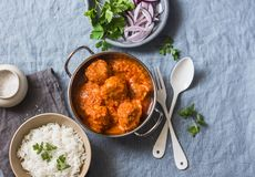 Chicken curry sauce meatballs and rice on a blue background, top view. Indian food. Healthy food. Concept Stock Photos