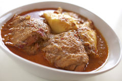 Chicken curry in thaifood. Chicken red curry and potato on white table Stock Photography