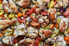 Chicken, cut into pieces, baked with vegetables in the oven Royalty Free Stock Photos