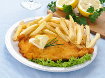 Chicken cutlet with chips Royalty Free Stock Photo