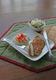 Chicken Cutlet dinner. With buttered rice and red pepper garnish and broccoli salad Stock Images