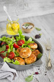 Chicken cutlet with fresh vegetable salad in a vintage pan Royalty Free Stock Images
