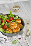 Chicken cutlet with fresh vegetable salad in a vintage pan Royalty Free Stock Image