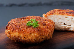 Chicken cutlet on an old wooden background Royalty Free Stock Images