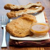 Chicken Cutlets. Slices of deep fried chicken cutlets served with spicy sauce Royalty Free Stock Photography