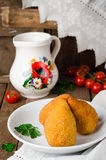 Chicken cutlets in breadcrumbs - Chicken Kiev in white bowl on wooden background. Ukrainian cuisine. Selective focus Stock Image