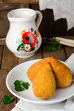 Chicken cutlets in breadcrumbs - Chicken Kiev in white bowl on wooden background. Ukrainian cuisine. Selective focus Royalty Free Stock Photography
