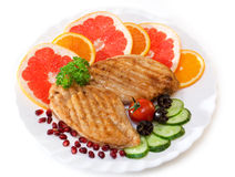 Chicken cutlets with a cucumber and a grapefruit Royalty Free Stock Image