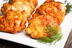Chicken cutlets. With dill in a white plate on the table Royalty Free Stock Images