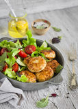 Chicken cutlets and fresh vegetable salad in a pan Stock Photos