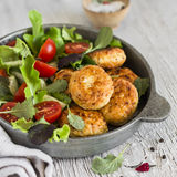Chicken cutlets and fresh vegetable salad in a vintage pan Royalty Free Stock Images