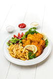 Chicken cutlets with fries and salad Stock Images