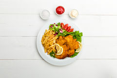 Chicken cutlets with fries and salad Royalty Free Stock Images