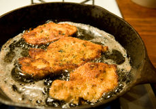 Chicken cutlets frying Stock Photography
